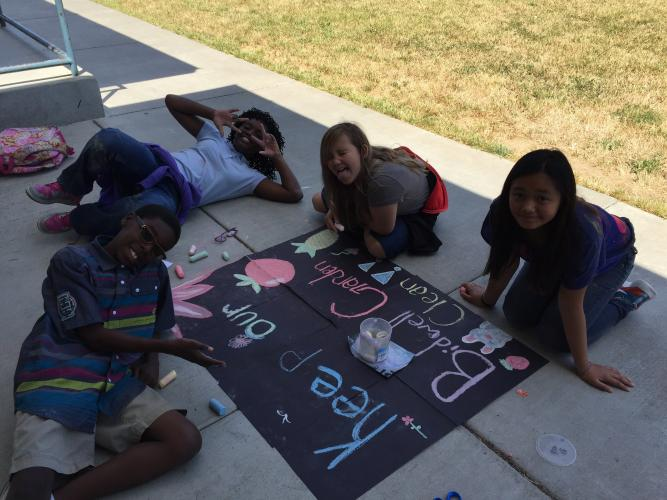 Student council working on signs to keep our garden safe.